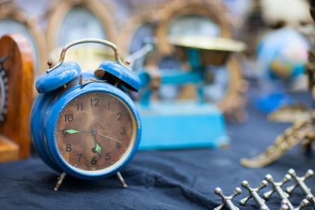 flea: Vintage blue alarm clock at flea market