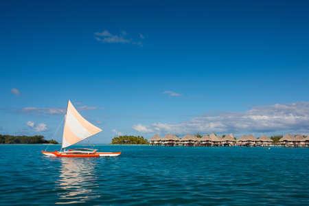 Sunset sailing at beautiful Bora Bora lagoon photo