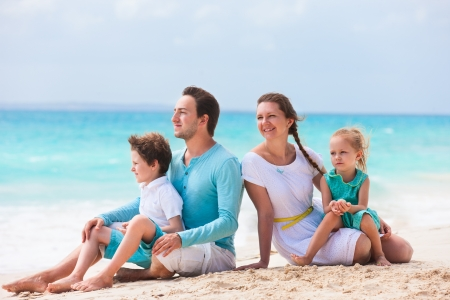 Portrait of a beautiful Caucasian family at tropical beach photo