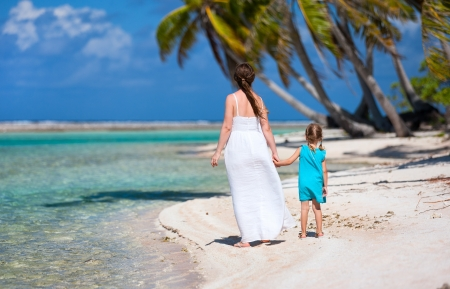 Back view of mother and daughter on a deserted island Stock Photo - 20366889