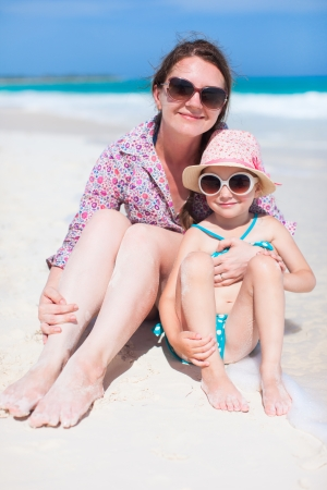 Mother and daughter enjoying time at tropical beach Stock Photo - 21896160