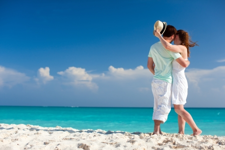 Back view of a couple on a tropical beach at Caribbean