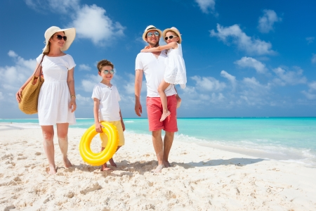 fun: Happy beautiful family on a tropical beach vacation
