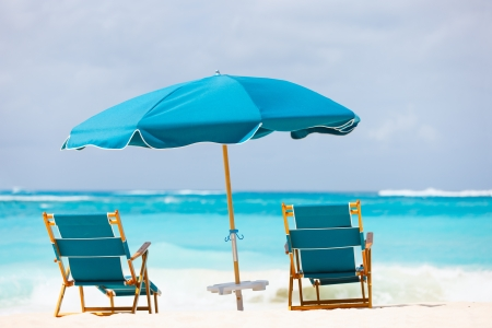 anguilla: Chairs and umbrella on a beautiful tropical beach at Anguilla, Caribbean