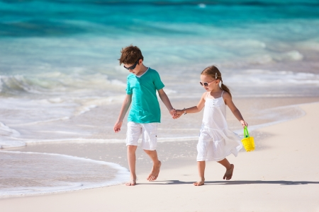 Two little kids at a tropical beach photo