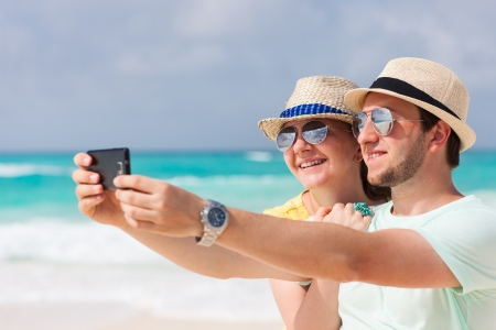 Yong couple making a self portrait with a mobile phone