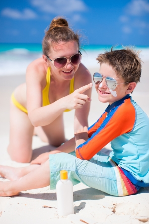 Mother and son portrait on beach vacation photo