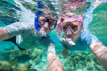 Underwater photo of a couple snorkelling in ocean photo