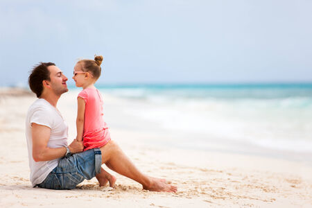 Father and daughter enjoying beach holiday vacation photo