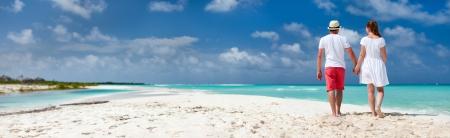 Panorama of a romantic couple at Caribbean beach