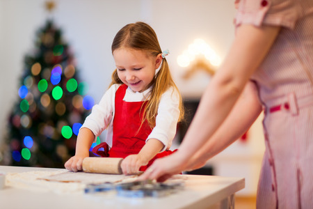 christmas girl: Little girl baking Christmas cookies at home