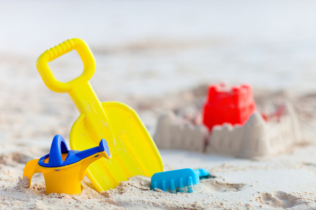sandcastle: Sandcastle and variety of colorful beach toys