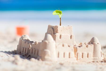sandcastle: Sand castle and beach toys at tropical coast