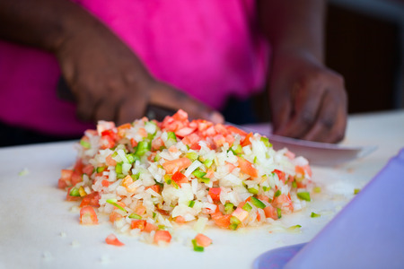 conch: Close up of Bahamian woman making traditional conch salad Stock Photo