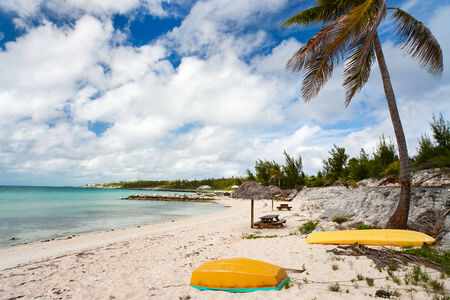 touched: Beautiful Caribbean beach with touched umbrellas on Bahamas Stock Photo