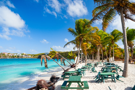 anguilla: Beautiful Caribbean beach with seaside cafe framed with palms