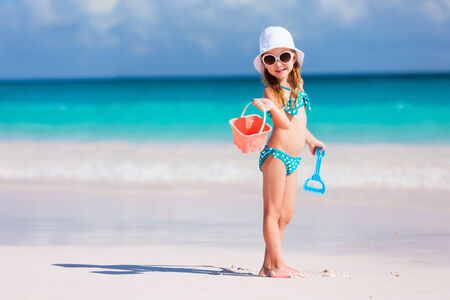 holiday summer: Adorable little girl at beach during summer vacation