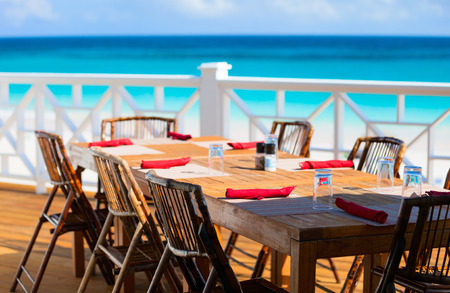 Tables at seaside restaurant with beautiful view photo