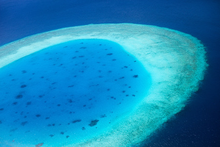 Aerial view of atoll in Maldives photo