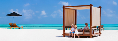 Happy beautiful family relaxing at beach during summer vacation Stock Photo