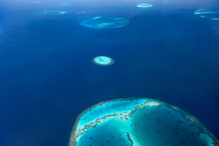 Maldives from above, aerial view of atoll photo