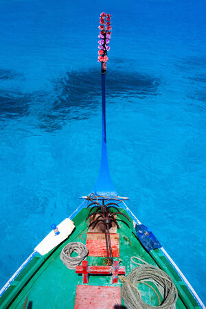 maldivian: Close up of a traditional maldivian boat dhoni in a tropical ocean  Stock Photo