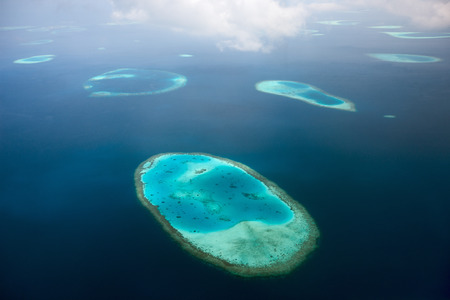 Aerial view of Maldives atoll and reefs seen from a sea plane photo