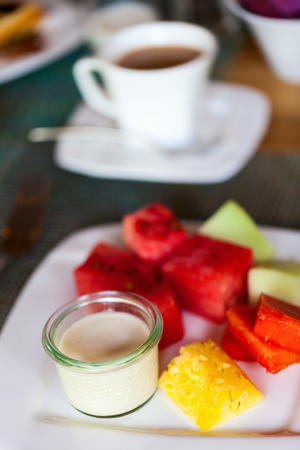 Delicious breakfast with tropical fruits and fresh yoghurt photo