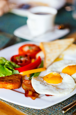Delicious breakfast with fried eggs, vegetables and toast photo