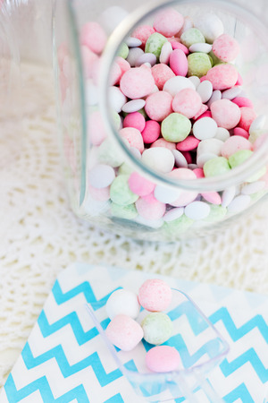 Candy jar on a dessert table at party or wedding celebration photo