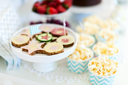 Berries, popcorn and canape selection at party table photo