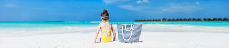 Adorable little girl at tropical during summer vacation. Wide panorama, perfect for banners photo