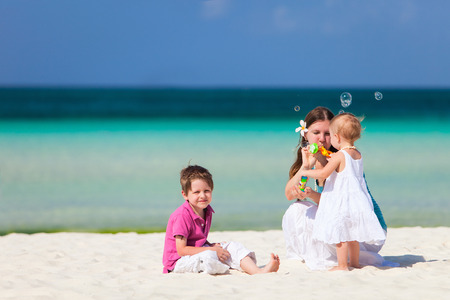 Mother and kids at tropical beach during summer vacation Stock Photo - 29258021