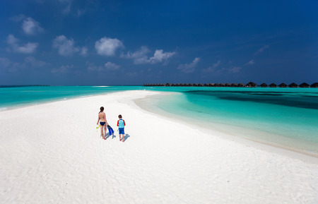 Above view of  mother and son walking at tropical beach with snorkeling equipment Stock Photo - 29258083