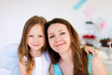 Mother and her adorable little daughter on a birthday party Stock Photo - 29258095