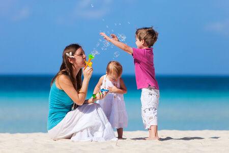 Mother and kids at tropical beach during summer vacation Stock Photo - 29258457