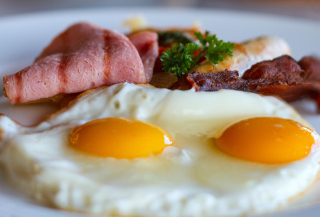 Delicious breakfast with fried eggs and bacon photo