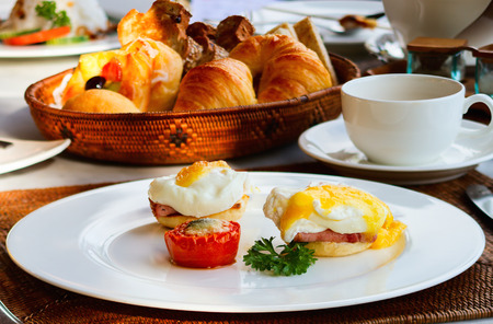 Eggs Benedict served for delicious breakfast Stock Photo