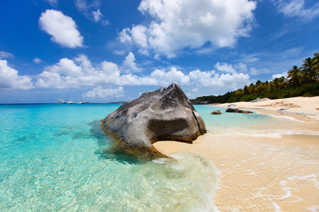 Beautiful tropical beach with white sand, turquoise ocean water and blue sky at Virgin Gorda, British Virgin Islands in Caribbean Stock Photo