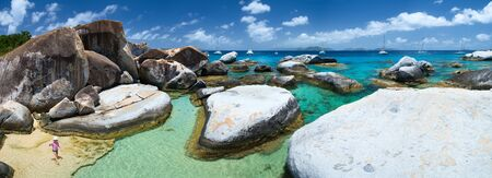 Panorama of The Baths beach area major tourist attraction at Virgin Gorda, British Virgin Islands with turquoise water and huge granite boulders, perfect for banners photo