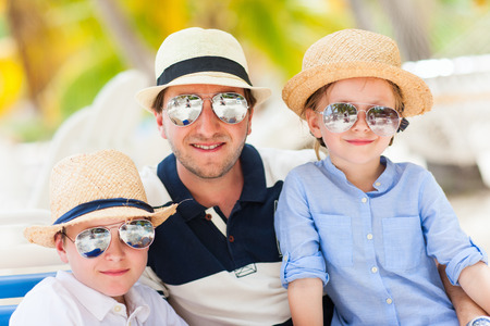 Happy father and his adorable kids enjoying summer vacation Stock Photo - 30071247