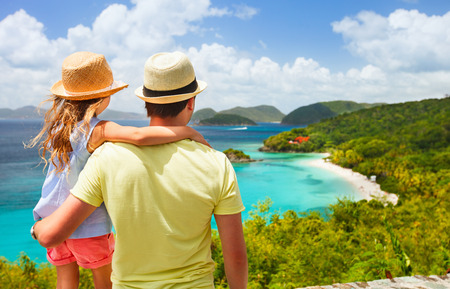 virgin islands: Family of father and daughter enjoying aerial view of picturesque Trunk bay on St John island, US Virgin Islands considered by many as most beautiful beach in Caribbean