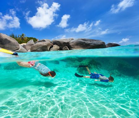 Split photo of mother and son family snorkeling in turquoise ocean water at tropical island of Virgin Gorda, British Virgin Islands, Caribbean photo