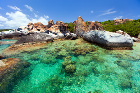 The Baths beach area major tourist attraction at Virgin Gorda, British Virgin Islands with turquoise water and huge granite boulders Stok Fotoğraf