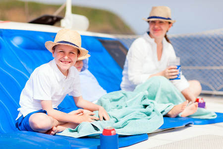 Mother and her kids relaxing having great time sailing at luxury yacht or catamaran boat Stock Photo - 30305613