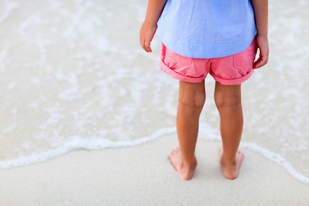 sandy feet: Close up of a little girl feet on tropical sandy beach Stock Photo