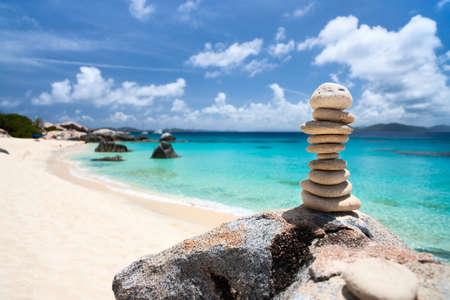 Stack of balances stones at tropical beach Stock Photo