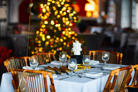 Beautiful table setting for Christmas party or New Year celebration in restaurant Stock Photo
