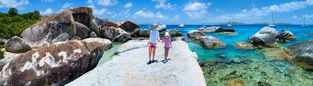 Family of mother and daughter enjoying view of beautiful scenery of The Baths beach area major tourist attraction at Virgin Gorda, British Virgin Islands, Caribbean photo