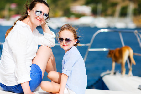 Mother, daughter and their pet dog sailing on a luxury yacht or catamaran boat Stock Photo - 30607972